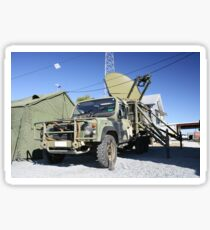 An Australian Defense Force Satellite Terminal Assembly is mounted on a 6x6 vehicle . Sticker
