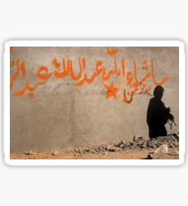 The shadow of a U.S`. Army soldier on the wall of an Afghan building. Sticker