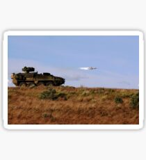 A TOW missile is launched from an armored vehicle. Sticker
