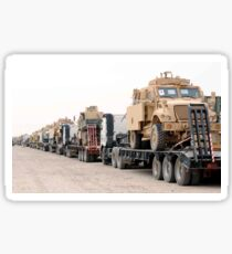A convoy of Mine-Resistant Ambush Protected vehicles ready for departure. Sticker