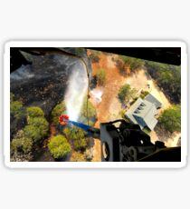 The Bambi Bucket attached to a CH-47 Chinook helicopter, dumps water on a wildfire in Texas. Sticker