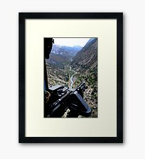 An aerial gunner surveys the surrounding area during a combat mission in Afghanistan. Framed Print