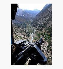 An aerial gunner surveys the surrounding area during a combat mission in Afghanistan. Photographic Print