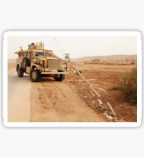 A MRAP vehicle disassembles an improvised explosive device. Sticker