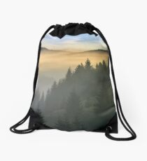 pine forest in fog at sunrise Drawstring Bag