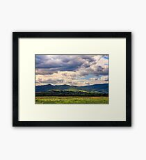 countryside summer landscape with field, forest and mountain ridge Framed Print
