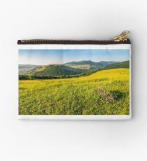 wild flowers on rural hillside Studio Pouch