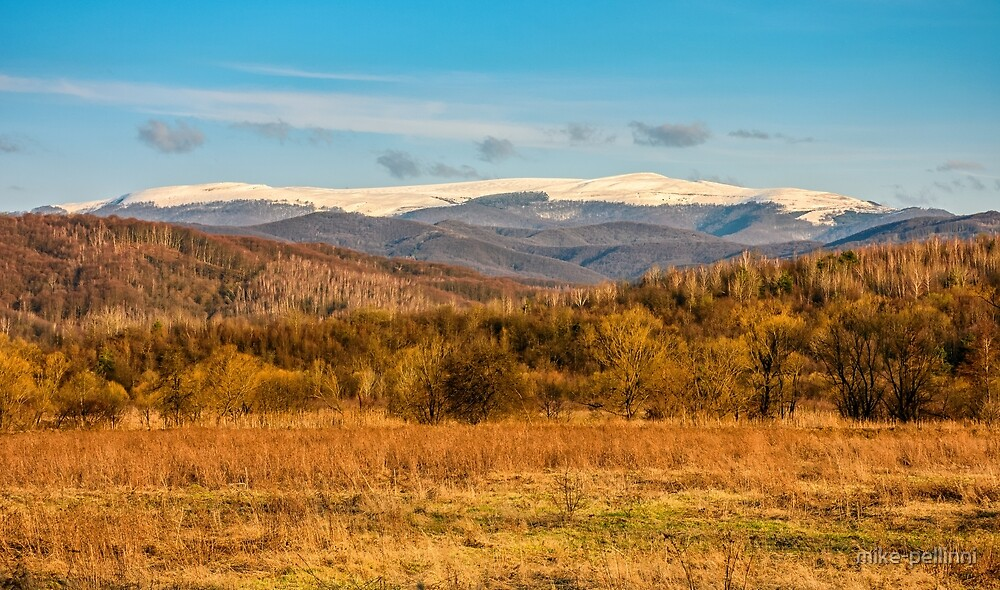 snowy peaks on the mountai top by mike-pellinni