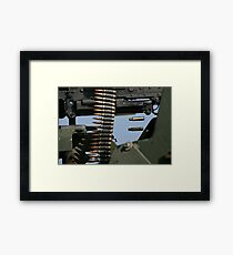 Expended brass falls from a machine gun. Framed Print