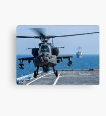An Army AH-64D Apache helicopter takes off from USS Ponce. Canvas Print