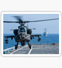 An Army AH-64D Apache helicopter takes off from USS Ponce. Sticker