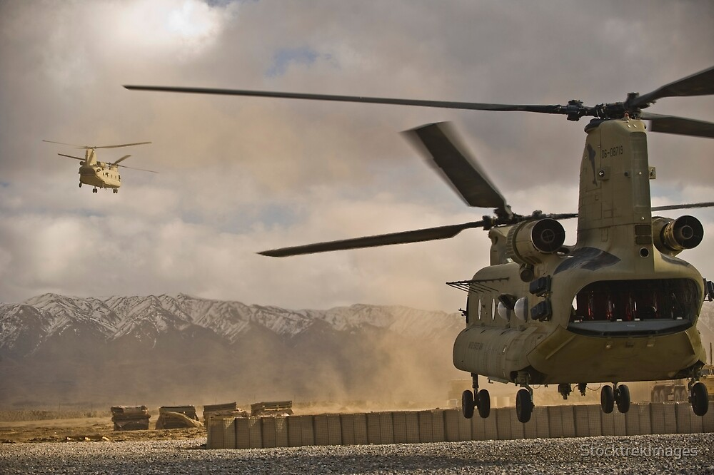 U.S. Army CH-47 Chinook helicopters depart a military base in Afghanistan. by StocktrekImages