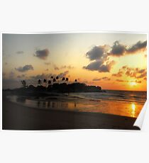 Palm tree silhouette at the beach during orange sunset. Poster