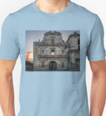 Facade of a ruined Church in Antigua, Guatemala with El Fuego volcano in the background. Unisex T-Shirt