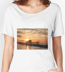 Stilt house over the sea in backlight Women's Relaxed Fit T-Shirt
