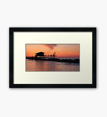 Stilt house over the sea Framed Print