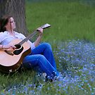 Young Girl Playing Guitar by Chet Scerra