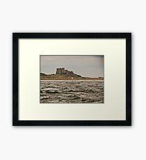 Bamburgh Castle by sea Framed Print