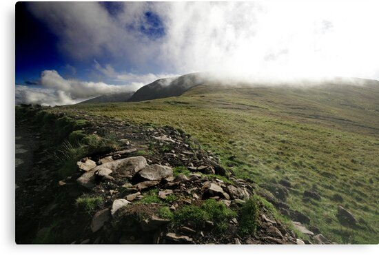 Fog rolls over the hill by Donncha O Caoimh