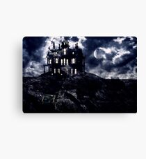 Haunted creepy house in ghastly moonlight Canvas Print