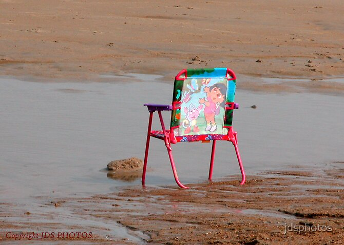A child's chair, all alone by jdsphotos
