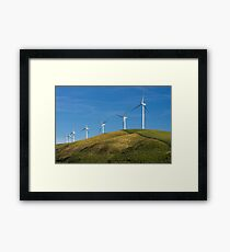 Row of wind turbines on hill Framed Print