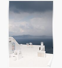 Two chairs on Santorini island Poster