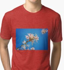 White flowers with pink over blue background Tri-blend T-Shirt