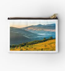 stacks of hay on the hill side Studio Pouch