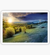 forest on a mountain hillside in rural area. day and night Sticker