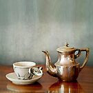 vintage cup of coffee and coffepot on a wooden table by gameover