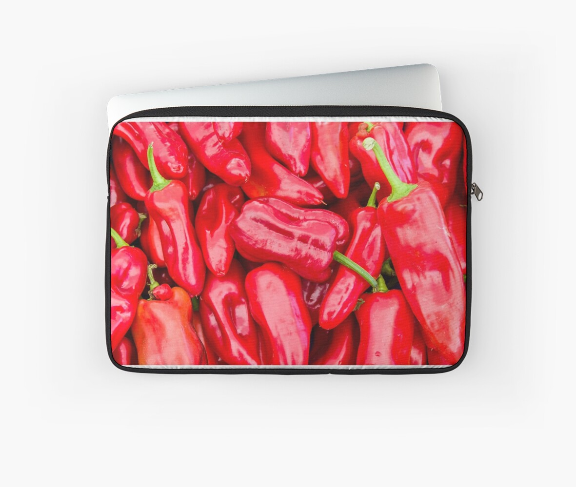 Red bell peppers on display by Zigzagmtart