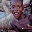 boy on the beach by Angus Beare