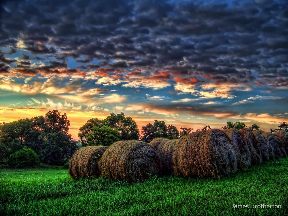 Hayrolls At Sunrise by James Brotherton