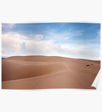 Desert dunes landscape with blue skies and white clouds. Poster