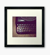 Typewriter on hardwood floor Framed Print