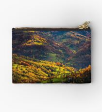 village in sunlit valley Studio Pouch