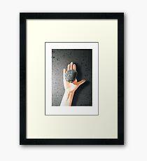 Hand Holding Shell Framed Print