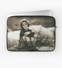 Cute girl with flowers field Laptop Sleeve