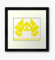 A distressed version of the Nakatomi Plaza symbol  Framed Print