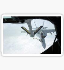 A Navy F/A-18F Super Hornet is refueled by a KC-135R Stratotanker. Sticker