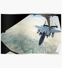 An F-15E Strike Eagle receives fuel from a KC-10 Extender. Poster