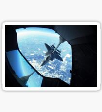 A F-22 Raptor refuels behind a KC-10 Extender. Sticker
