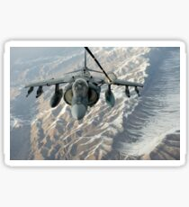 An A/V-8B Harrier receives fuel over Afghanistan from a KC-10 Extender. Sticker