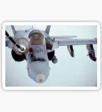 An F/A-18 Super Hornet receives fuel over Afghanistan. Sticker