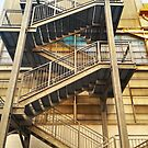 Yellow facade with external staircase by Roberta Angiolani