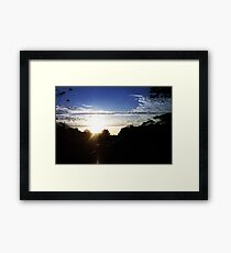 Sunset from inside a cab Framed Print
