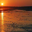 Sunset over the beach by Arie Koene