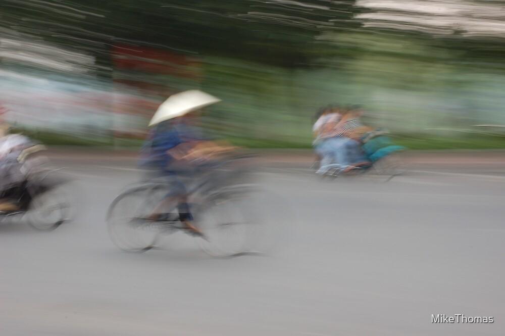 Hanoi cyclists by MikeThomas