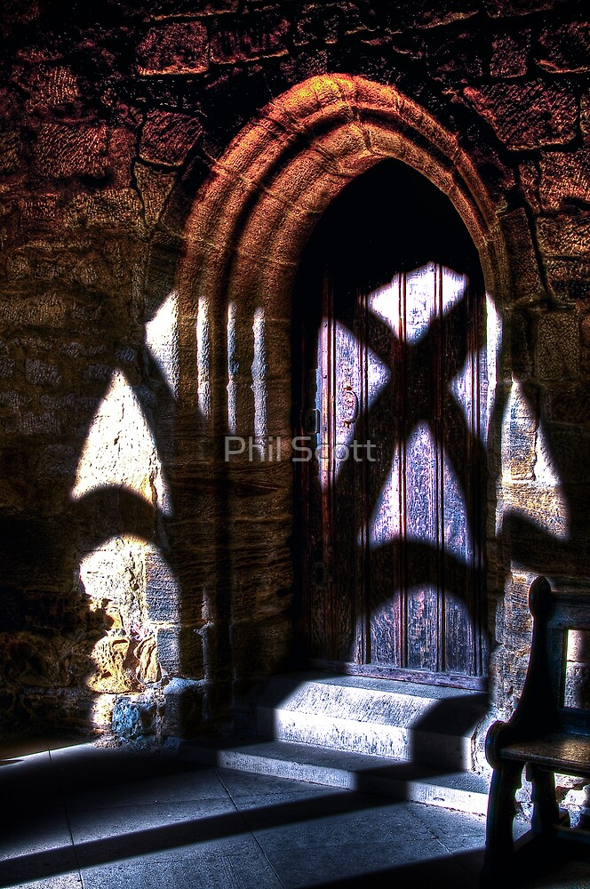 Cathedral doorway in shadow by Phil Scott